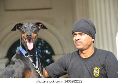28 June 2019, Kolkata , India: A young unidentified black cat commandos soldier giving training to his Dog in a old building.