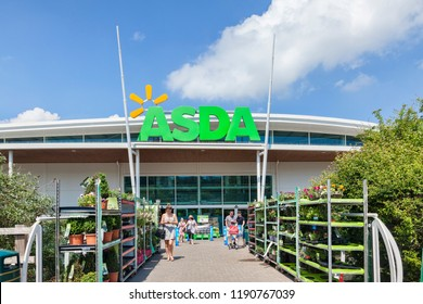 28 May 2018: Newton Abbot, Devon, UK - Asda supermarket entrance, with people leaving with their shopping.