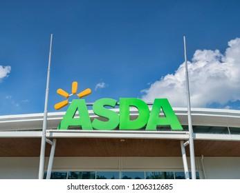 28 May 2018: Newton Abbot, Devon, UK - Asda logo against blue sky.