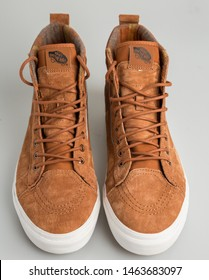 28/07/2019 Brown Brand New Leather Material Vans Hi Top Skate Shoes studio lighting white background isolated can be cut out on request scotch guard clean retro hipster shoes skate fashion