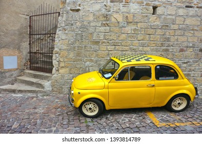 28.08.2016. Matera Pietrapertosa, Basilicata Italy - vintage yellow car Fiat 500 on the old narrow street with stone path in small village in South Italy