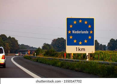 28/08/2019 Nederlande. Nederlane esign at the border between Germany and Netherlands with text on the road sign with European union stars.