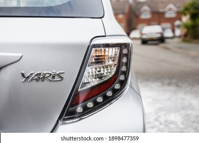 28,11,2020, London, England, Rear of the toyota yaris 2014 showing the logo and the name and model of the car and the brand new clear brake light cluster on the fender of the vehicle restoration