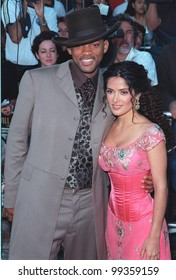 """28JUN99:  Actor WILL SMITH and actress SALMA HAYEK at the world premiere of their new movie """"Wild Wild West"""" in Los Angeles.  Paul Smith / Featureflash"""
