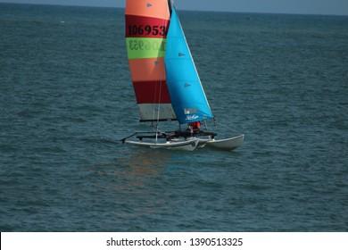 28th April, 2019, Takwa Bay Beach, lagos, Nigeria, two men cruise in a multi-color Yacht near Eko Atlantic City by takwa bay beach.