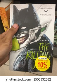 28th August 2019, Shah Alam, Malaysia. Hand holding a Batman novel written by Christa Faust & Gary Phillips at the bookstore.