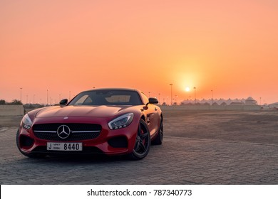 28th December 2017 - Abu Dhabi, UAE. Red front mid-engine supercar developed by Mercedes AMG in front of a beautiful sunset.