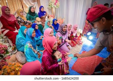 28th June 2019, Kuala Lumpur Malaysia. Beautiful bride and bridesmaid indoor photoshoot. Malaysian Muslim wedding. Beautiful bride with her pretty bridesmaids. Stylish bridesmaids having fun on nature