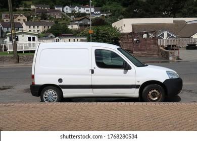 28th June 2020- A white Peugeot Partner 600D light van parked on the main street in Pendine, Carmarthenshire, Wales, UK.
