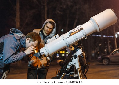 29 APRIL 2017, UFA, RUSSIA: People come to look at the stars and the moon in a professional telescope mounted by local amateur astronomers