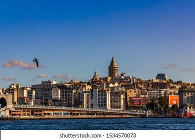 29 August 2019; Golden Horn, Istanbul, Turkey; View of the Galata Tower through the strait in the morning.