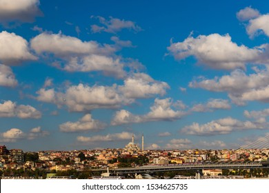 29 August 2019; Turkey, Istanbul; cityscape view on a bright day with puffy white clouds hovering over the city.