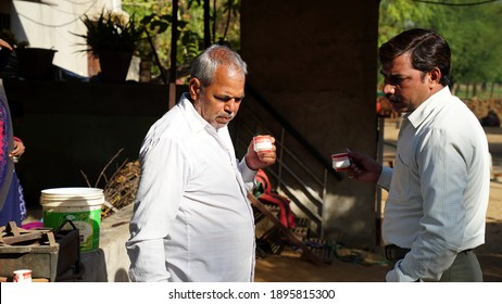 29 December 2020, Reengus Jaipur, India. Young adult Indian Chef and Halwai taking tea and inspection the prepared food for wedding.
