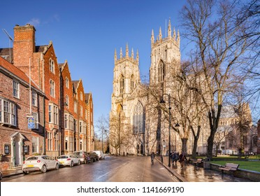 29 January 2015: York, UK - The West facade of York Minster, seen in winter from Duncombe Place after a shower.