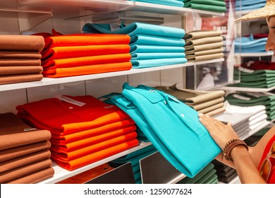 29 JULY 2018, BARCELONA, SPAIN: Customer woman choosing shirt and other clothes in shopping mall