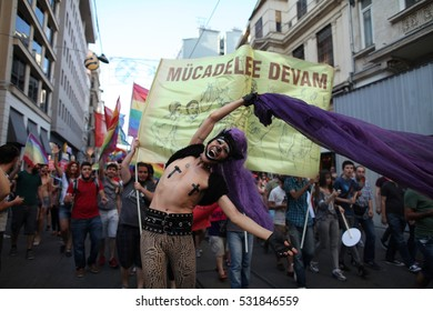 29 June 2014, Istanbul, Turkey.People march during the  LGBT (Lesbian, Gay, Bisexual, Transsexual) pride in Istiklal Street. colorful parade held in istanbul as people wearing masks kissing each other