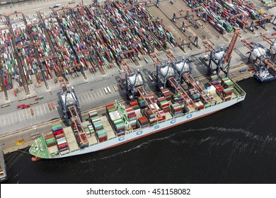 29 June 2016, Rotterdam, Holland. Aerial view of container terminal in the harbor  MAASVLAKTE, Netherlands. A large containership from Cosco is unloading.