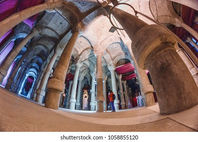 29 SEPTEMBER 2017, ISTANBUL, TURKEY:  Woman tourist in ancient underground travel destination, storage of fresh water Yerebatan Saray or Cistern Basilica