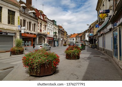 29.07.2018. Condé-sur-l'Escaut - commune of the Nord department in northern France lies on the border with Belgium. Center of ancient town at summer. Street of old town