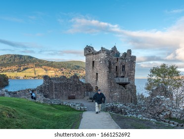29-Oct.,2019 : Tourists exploring ruins of Urquhart castle which sits behind Loch Ness in the highland ofscot land,U.K.