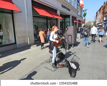 29th March 2019, Dublin, Ireland. Busker performing on Grafton Street, Dublin City Centre.