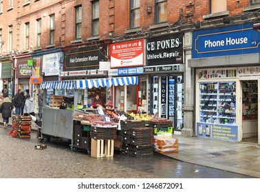 29th November 2018 Dublin. The changing nature of Dublin's iconic Moore Street, now filled with mobile phone shops and international themed stores, and fewer fruit and veg stalls than before.