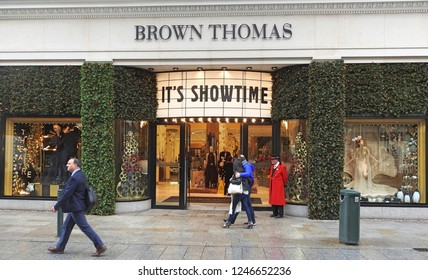 29th November 2018 Dublin.  A festive Brown Thomas department store entrance with doorman in red costume on Grafton Street, Dublin City Centre.