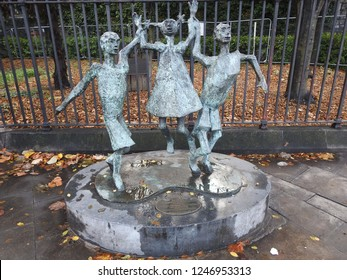 "29th November 2018 Dublin. John Behan's 2000 sculpture, ""Millennium Child,"" celebrating children in the new millennium, outside the Peace Park at Christchurch Place, Dublin, Ireland."