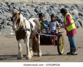 29th September 2018- People with a horse and carriage on the sandy beach at Pendine, Carmarthenshire, Wales, UK.