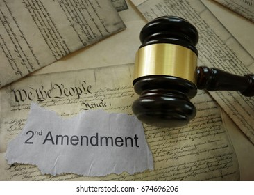 2nd Amendment news headline on a copy of the US Constitution
