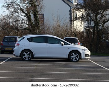 2nd December 2020- A stylish white Seat Leon S Emocion Tdi T, five door hatchback car, parked in the town carpark at Amroth, Pembrokeshire, Wales, UK.