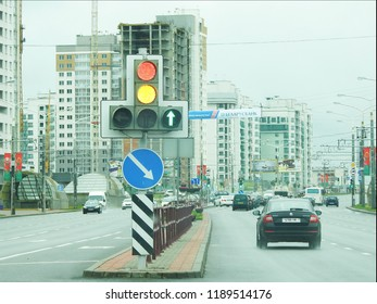 2nd of July 2017 - Scene from a Belarusian city with view past traffic lights to a busy highway, Minsk, Belarus