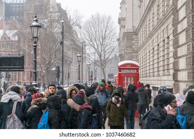 """2nd March 2018 - London, England. People in Westminster covering from cold wind and snow brought by the """"Beast from the East""""."""
