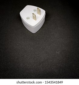 2-pin adapter plug, electrical adapters isolated on black background
