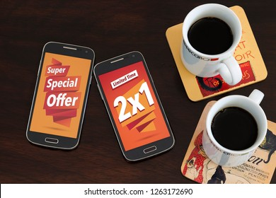 2x1 advertising, Special Offer. Two cell phones and two coffee cup over the table. Marketing, Internet business. Sales.