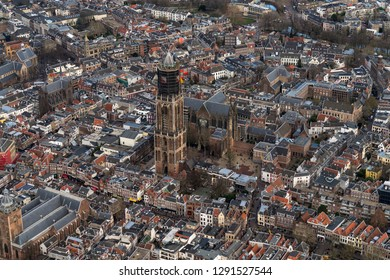 3 -1-2019, Utrecht, Holland. Aerial view of Dom church, downtown. The tower is being renovated and a large black scaffolding has been built around it. Many shopping streets and authentic houses.