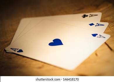 3 Aces On Wooden Floor