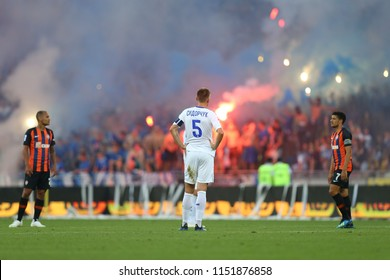 3 AUGUST, 2018 - KIEV, UKRAINE: Pyro show by ultras on the stands, Serhiy Sydorchuk back on foreground. Ukrainian Premier League. Dynamo Kyiv - Shakhtar Donetsk