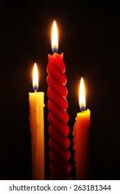 3 Candles on dark background