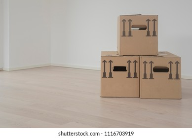 3 cardbox packaging box on wooden floor in empty room - moving day