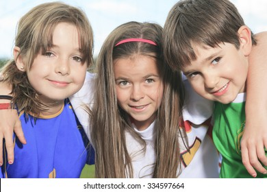 3 Childen play soccer on summer season
