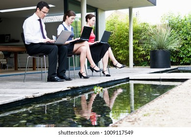 3 colleagues work outdoors