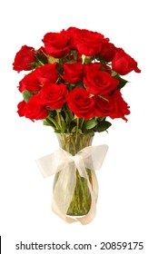 3 dozen red roses in a glass vase and a white bow isolated