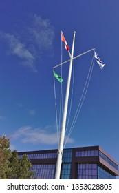 3 flags on mast blue sky canadian, nova scotia and cape breton