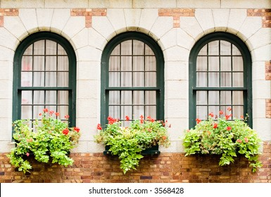 3 Frontenac's castle windows with flower boxes