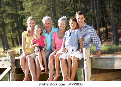 3 Generation family sitting by lake