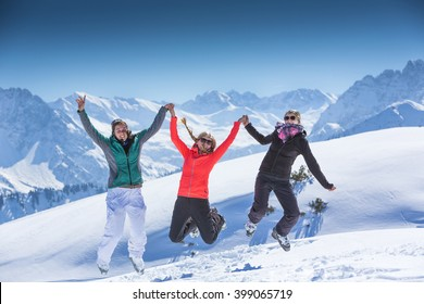 3 Girls having fun in winter holidays