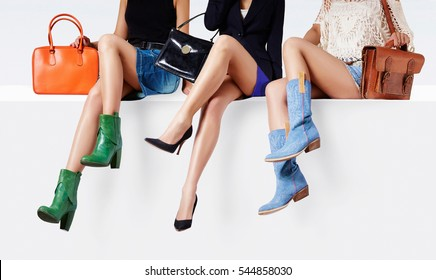 3 girls sitting together with colorful shoes and purses. Woman fashion collection. Different look for daily lifestyle.