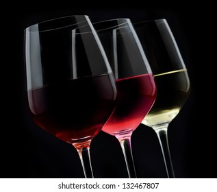3 glasses of wine in dark background
