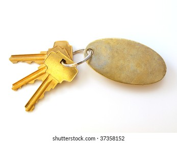 3 Gold Keys and blank keychain white